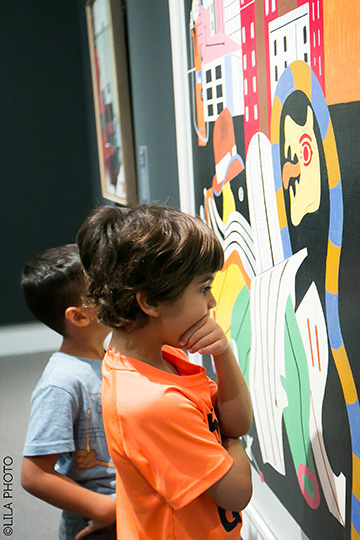 Young visitors examine Stuart Davis' painting at the Norton Museum of Art